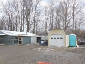 several shops, storage, heated office ,lots  of parking,  secure