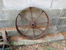 BARGAIN PRICE FOR A VINTAGE CAST IRON WHEEL