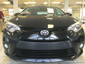 Priced to sell 2014 Toyota Corolla LE Sedan very Low KM