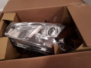 2009-2014 nissan maxima driver side headlight brand new in box