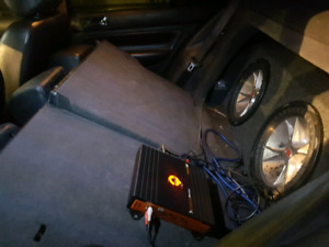 Two 12 inch cvr kicker subs and amp