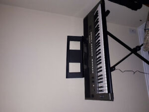 Yamaha keyboards with stand and music holder