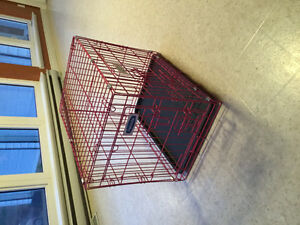 Small pink dog cage