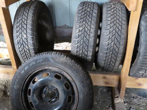 4 Goodyear winter tires on rims, 185-65R15