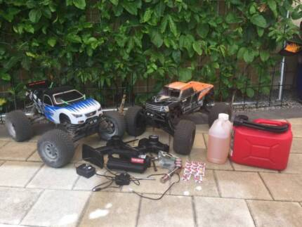 Two HPI nitro 4x4 R/C trucks, complete package, ready to play.
