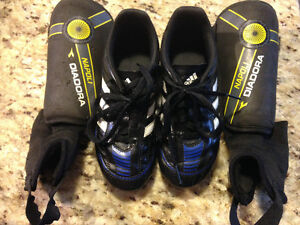 Junior soccer cleats and shin pads (2 sets)