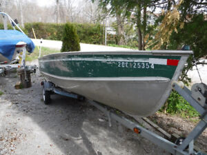 16 Ft Lund Aluminum Fishing Boat 20 Hp Merc and Trailer