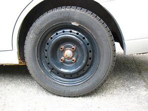 4 winter tires (Michelin X-Ice 195/60R15) on rims