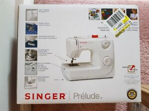 SINGER prelude sewing machine *New* in the box never used.