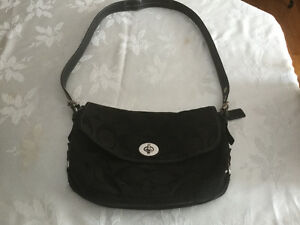 Ladies Authentic black coach over the shoulder/cross body purse