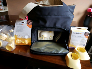 Medela double pump with accessories
