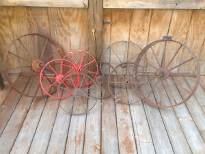 Antique steel wheel barrow & implement steel wheels