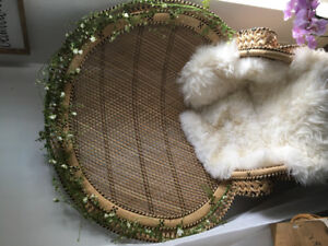 Peacock wicker chair with greenery