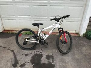 24 inch CCM 18 speed full suspension Mountain Bike.