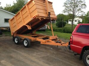 REDUCED Dump trailer with new axles and tires 5500.00 New MVI