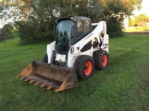 2011 Bobcat S650 Skid Steer with Enclosed Cab and Tooth Bucket