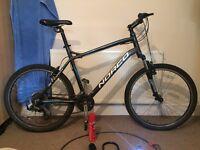"""Norco 21"""" mountain bike."""
