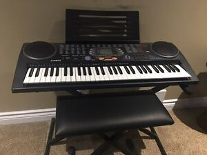 Casio keyboard with bench, stand and book stand