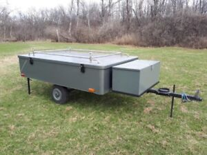 Motorcycle or small car tent trailer.