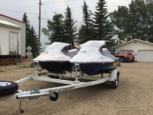 Two Sea Doo rx di watercrafts with trailer