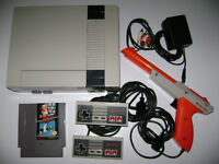 Nintendo System with 2 controllers , light gun and games
