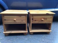 A pair of pine bedside cupboards
