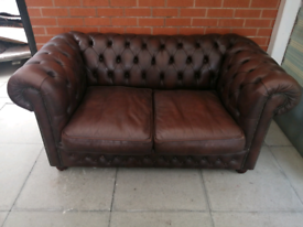 A Dark Brown Leather Chesterfield Two Seater Sofa