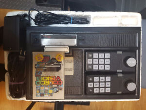 colecovision system all hook ups, styro insert and 11 games