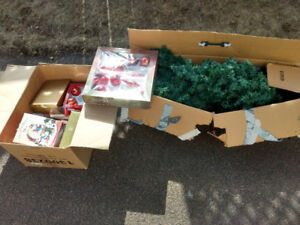 Used Christmas tree and various ornaments