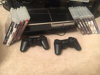 PS3- with 2 controllers + loads of games