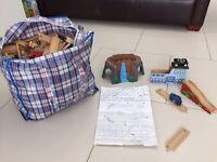Extra large bag of wooden trains and tracks Plus train table