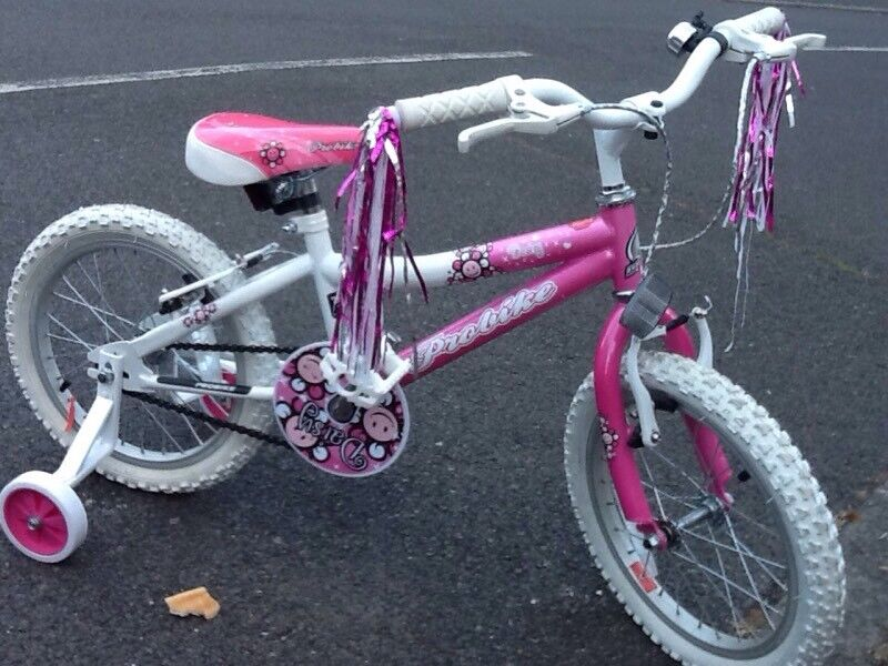 """Kids Bike - Probike Daisy Pink Bike 16"""" with Stabilizers and helmet in nearly as new conditi"""