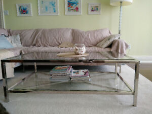 Designer glass and chrome/stainless steel two level coffee table