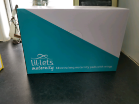 Sealed box of maternity pads free to collect