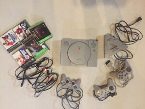 PlayStation one with three controllers and 5 games