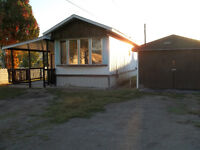 YOUR OWN LAND + MOBILE HOME / GARAGE AND HALF ACRE LOT