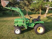 John Deere 855 4 Wheel Drive with a loader
