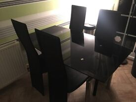 Black glass and leather chairs dining room table