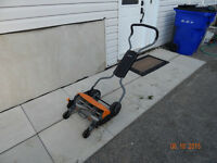 New price Fiskers Momentum Reel Mower