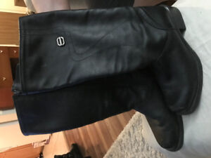 Ladies size 8 long black leather boots.