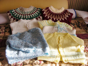 7 Baby sweaters (NEW)