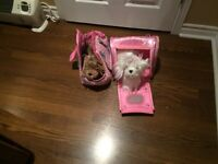 Toy puppies with separate carrying cases.