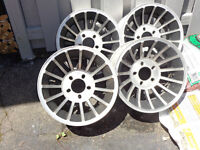 set of four turbine wheels with centre  caps new price