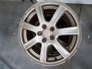 "Set of 4 16"" Subaru rims."