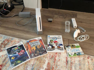 Nintendo Wii with set of games and one controller