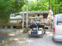 31 ft Camper with Boat, Motor, Golf Cart plus more in Muskoka