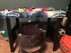 Air hockey table, TV, chair, and a bunch of other stuff!