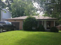 5 bed, 2 bath, laundry, 5 parking spots, garage, private yard