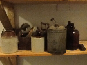 Variety of antique farm items and bottles