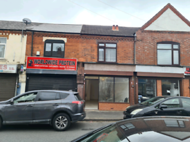Shop and flat to let